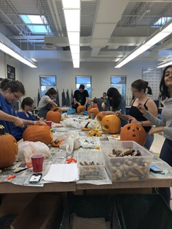 Art Club carving pumpkins