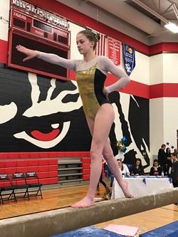 Tara Gologram competing at gymnastics event