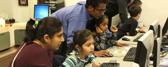 Families participate in the Hour of Code during the District's inaugural Night of Code